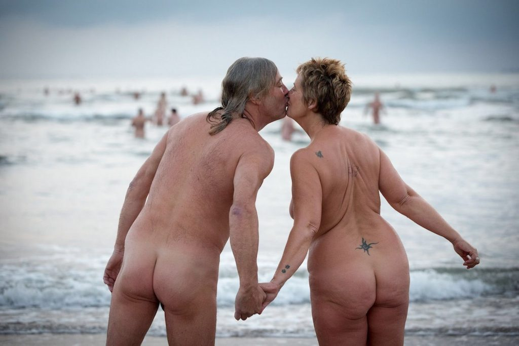 nudists kissing on the beach